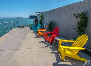 Colorful chairs at the lower patio